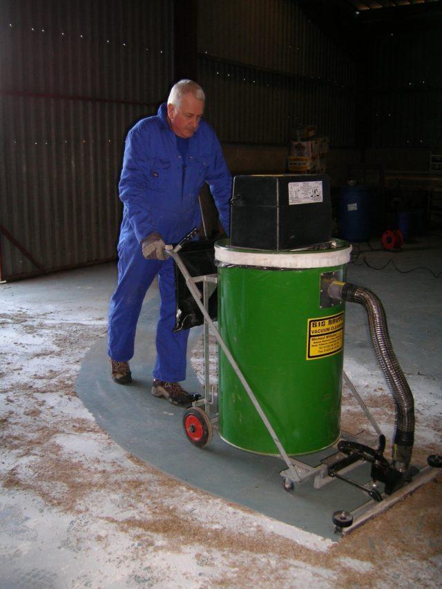 Big Brute Warehouseman Cleaning A Dusty Floor